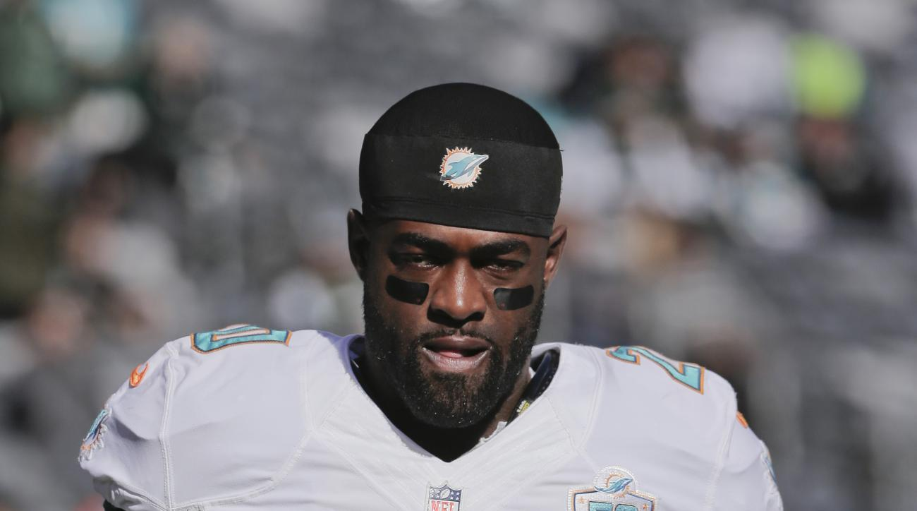 Miami Dolphins strong safety Reshad Jones (20) walks on the field before an NFL football game against the New York Jets Sunday, Nov. 29, 2015, in East Rutherford, N.J. (AP Photo/Julie Jacobson)
