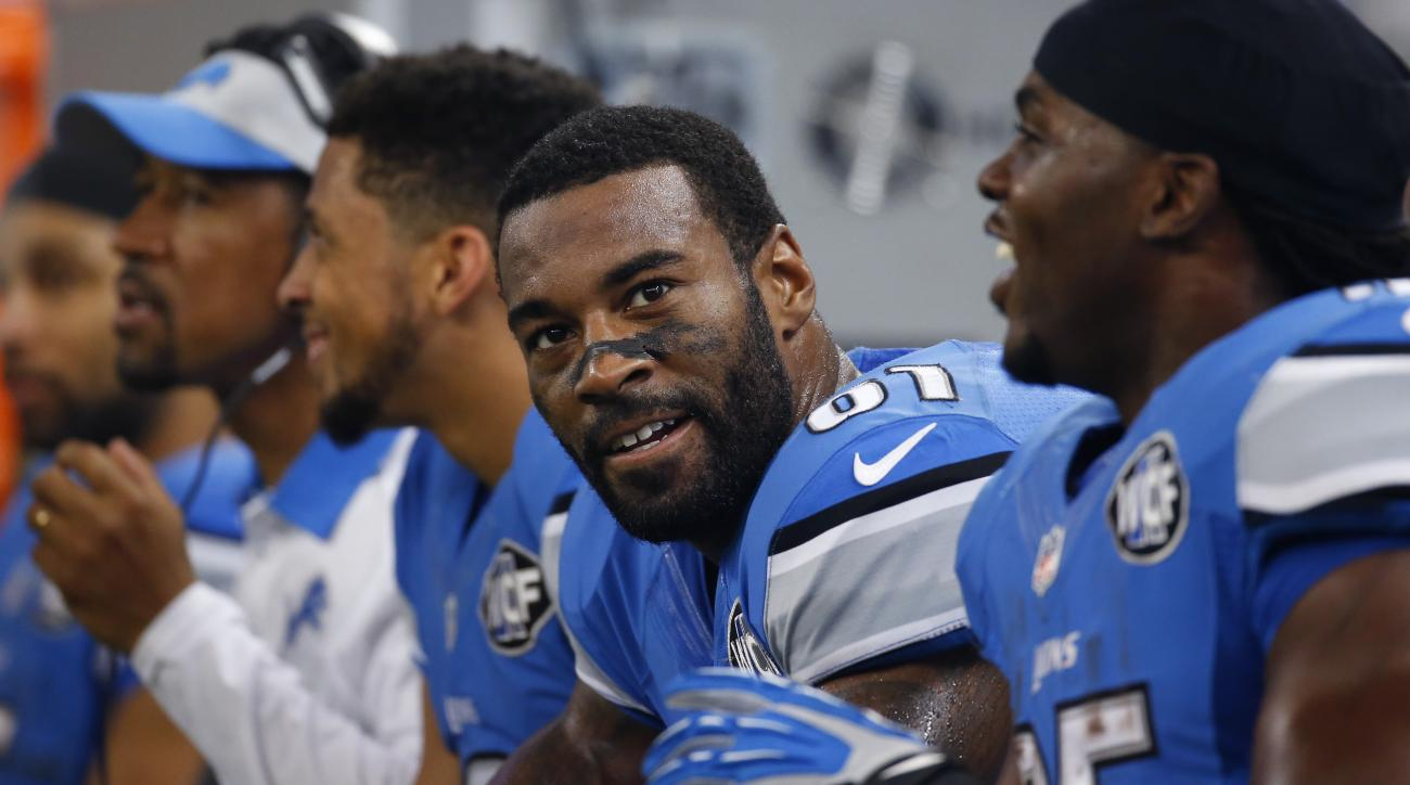 FILE - In this Nov. 26, 2015, file photo, Detroit Lions wide receiver Calvin Johnson (81) sits on the bench during the second half of an NFL football game against the Philadelphia Eagles, in Detroit. The Lions will play against the San Francisco 49ers  on