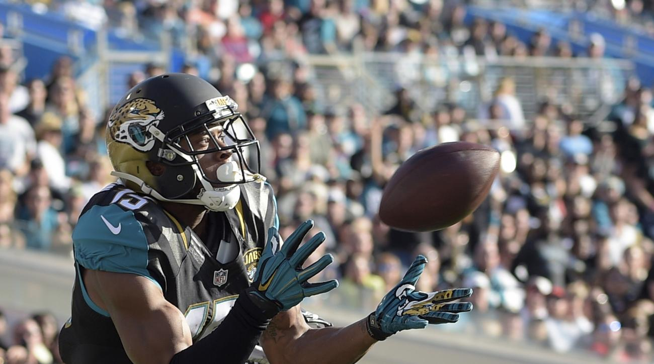 File- This photo taken Dec. 20, 2015, shows Jacksonville Jaguars wide receiver Allen Robinson, left, making a touchdown catch in front of Atlanta Falcons cornerback Desmond Trufant during the second half of an NFL football game in Jacksonville, Fla. Robin