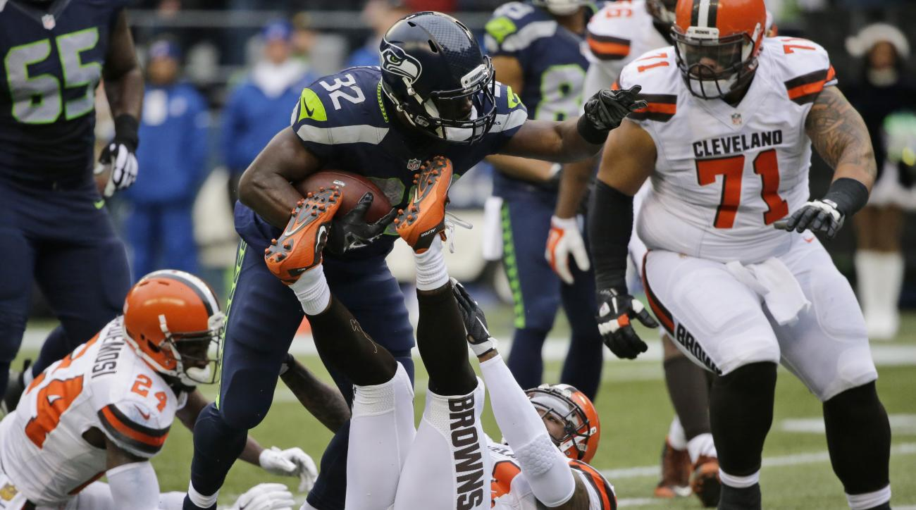 FILE - In this Dec. 20, 2015, file  photo, Seattle Seahawks' Christine Michael (32) carries against the Cleveland Browns during an NFL football game in Seattle. Michael rushed for a career-high 84 yards on just 16 carries in Seattle's win over Cleveland.