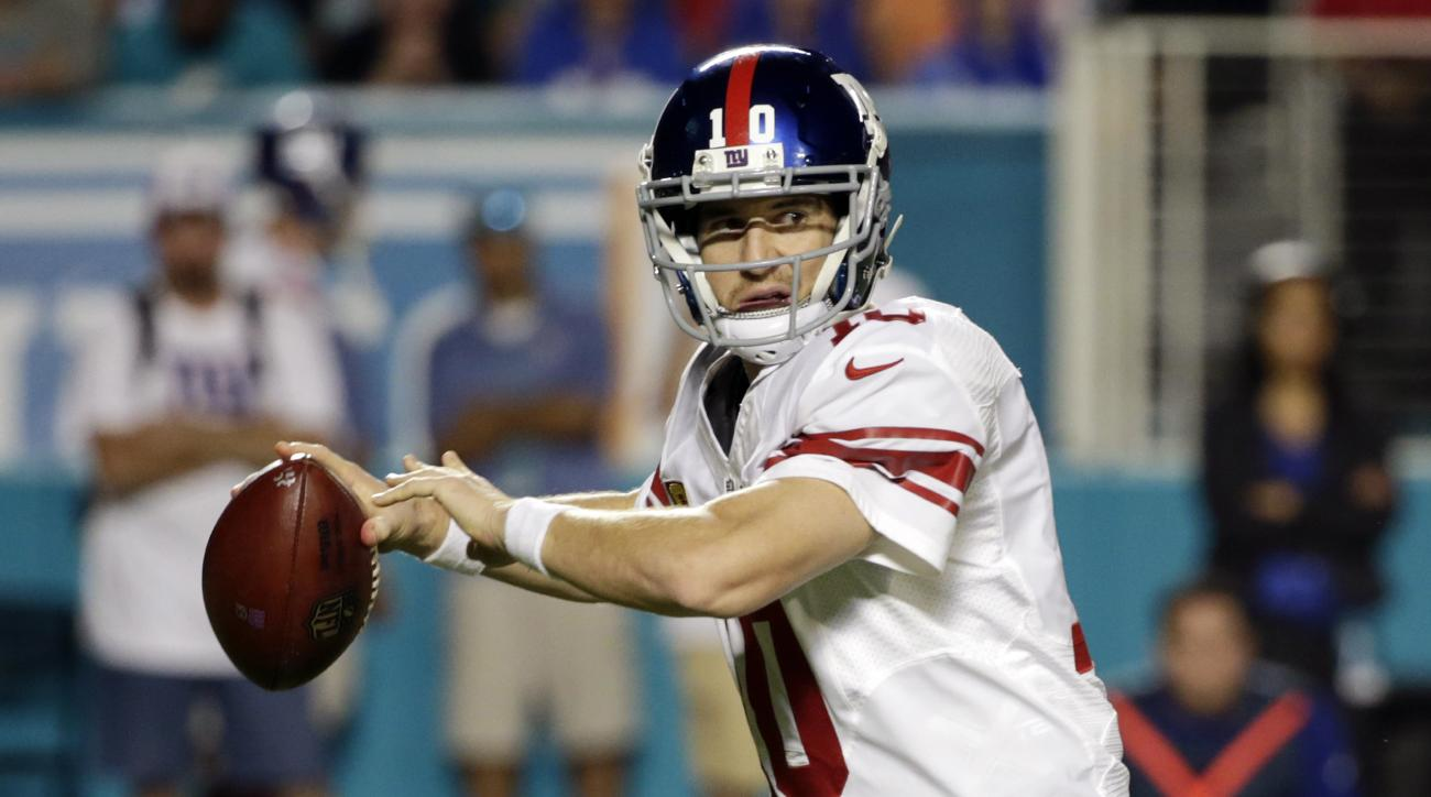 ADVANCE FOR WEEKEND OF DEC. 26 & 27 - FILE - In this Dec. 14, 2015, file photo, New York Giants quarterback Eli Manning looks to pass during the second half of an NFL football game against the Miami Dolphins, Monday, Dec. 14, 2015, in Miami Gardens, Fla.