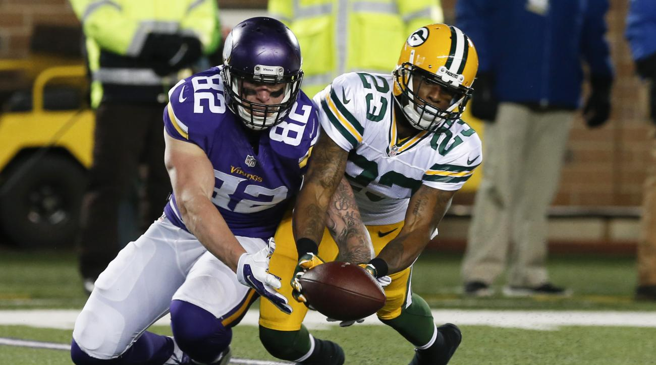 FILE - In this Sunday, Nov. 22, 2015, file photo, Green Bay Packers cornerback Damarious Randall (23) breaks up a pass to Minnesota Vikings tight end Kyle Rudolph (82) during the second half of an NFL football game in Minneapolis. The Vikings and Packers