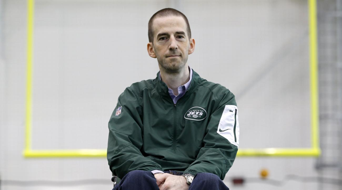 In a photo taken Friday, Dec. 4, 2015, Rich Bedell, manager of team operations for the New York Jets NFL football team, poses for The Associated Press at the team's training facility in Florham Park, N.J. Being in a wheelchair hasn't stopped Bedell from m