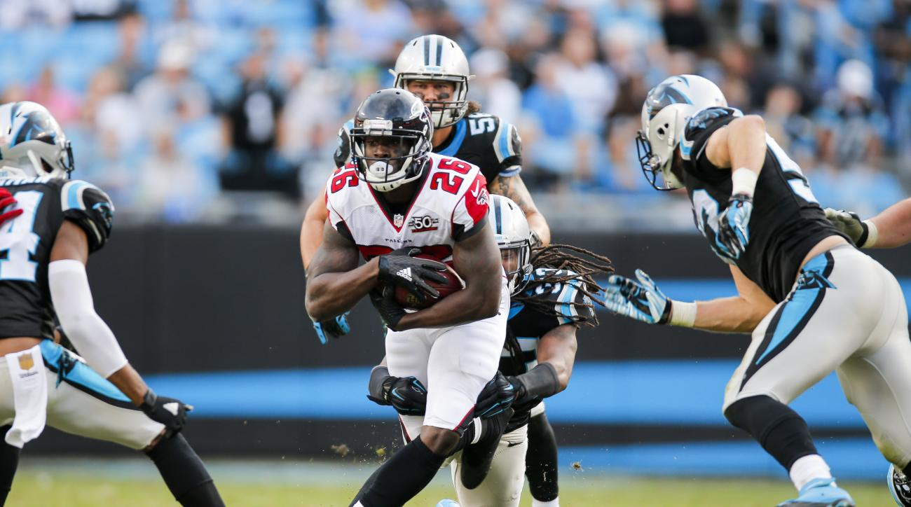 Atlanta Falcons running back Tevin Coleman (26) runs the ball against the Carolina Panthers during an NFL football game at Bank of America Stadium in Charlotte, N.C. on Sunday, Dec. 13, 2015. (Chris Keane/AP Images for Panini)