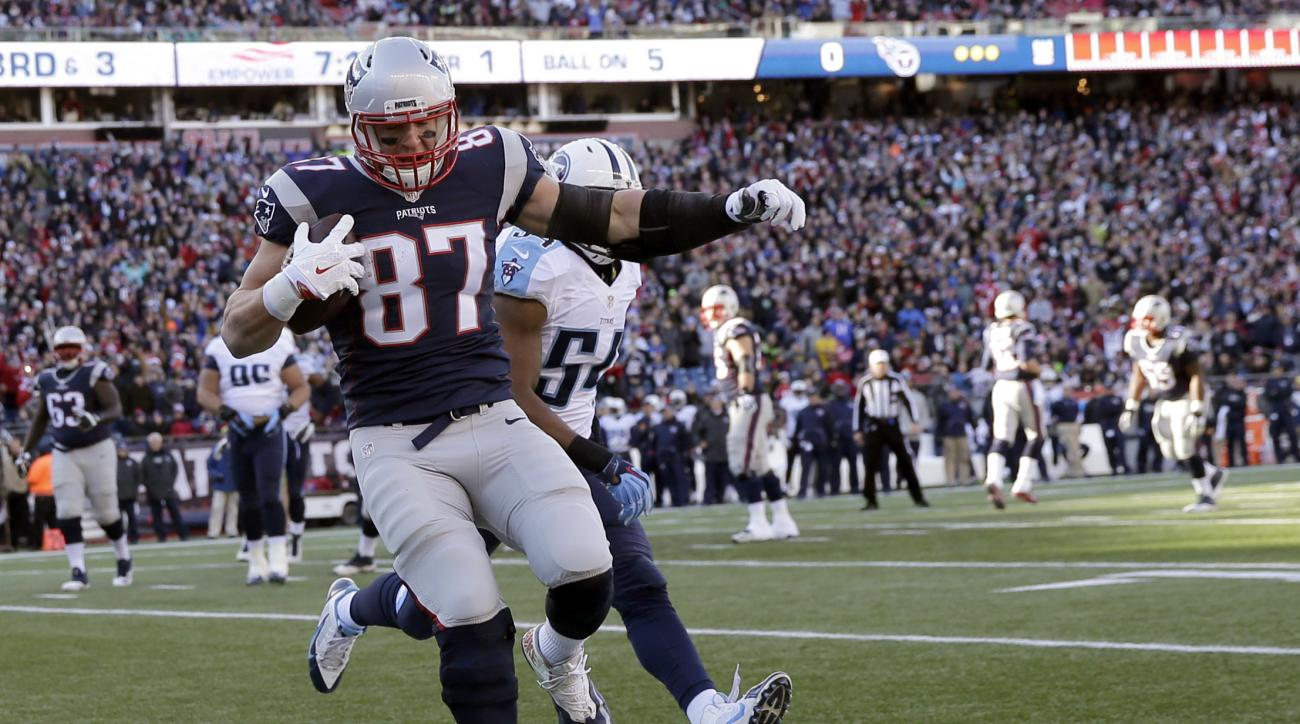 FILE - In this Sunday, Dec. 20, 2015, file photo, New England Patriots tight end Rob Gronkowski (87) catches a pass for a touchdown in front of Tennessee Titans linebacker Avery Williamson (54) in the first half of an NFL football game in Foxborough, Mass
