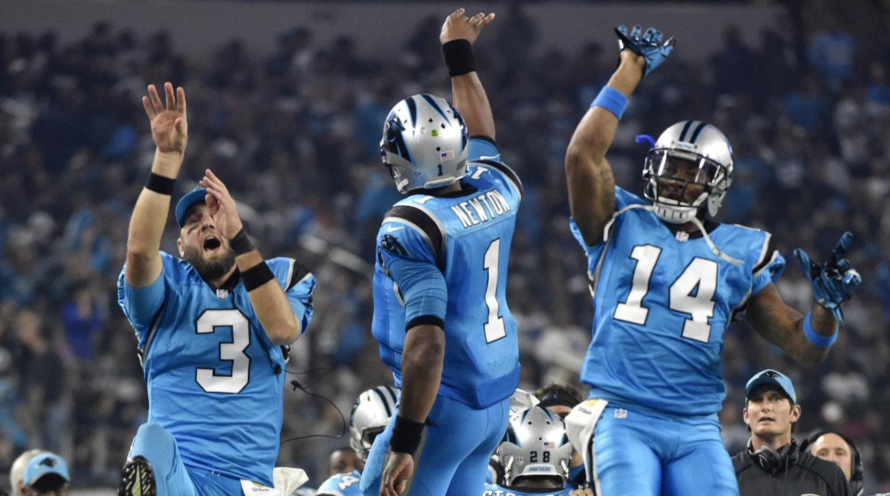 File-This Nov. 26, 2015, file photo shows Carolina Panthers' Derek Anderson (3) and Joe Webb (14) celebrating with Cam Newton (1) after Newton scored a touchdown on a running play during the second half of an NFL football game against the Dallas Cowboys,