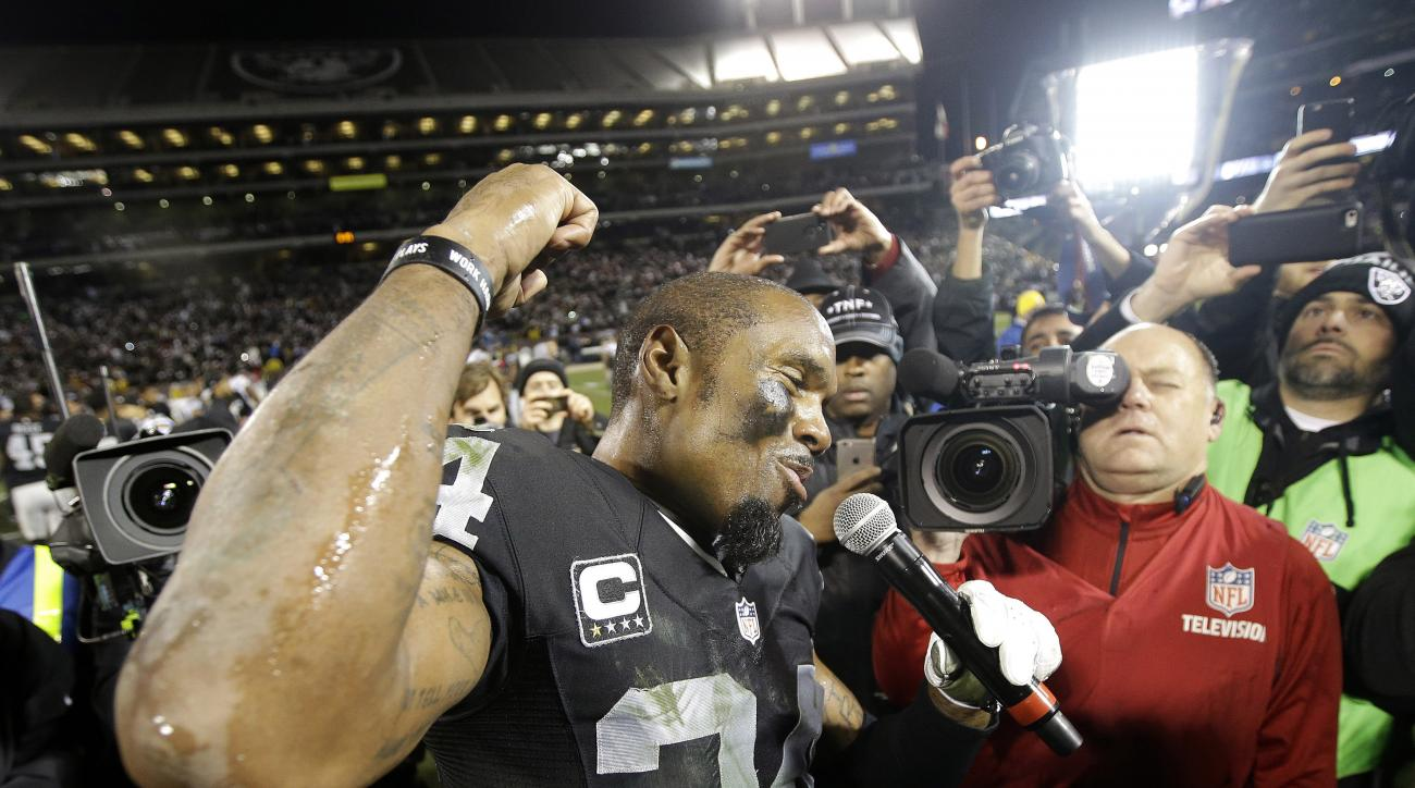 Oakland Raiders cornerback Charles Woodson (24) addresses the crowd after an overtime period of an NFL football game against the San Diego Chargers in Oakland, Calif., Thursday, Dec. 24, 2015. The Raiders won 23-20. (AP Photo/Marcio Jose Sanchez)