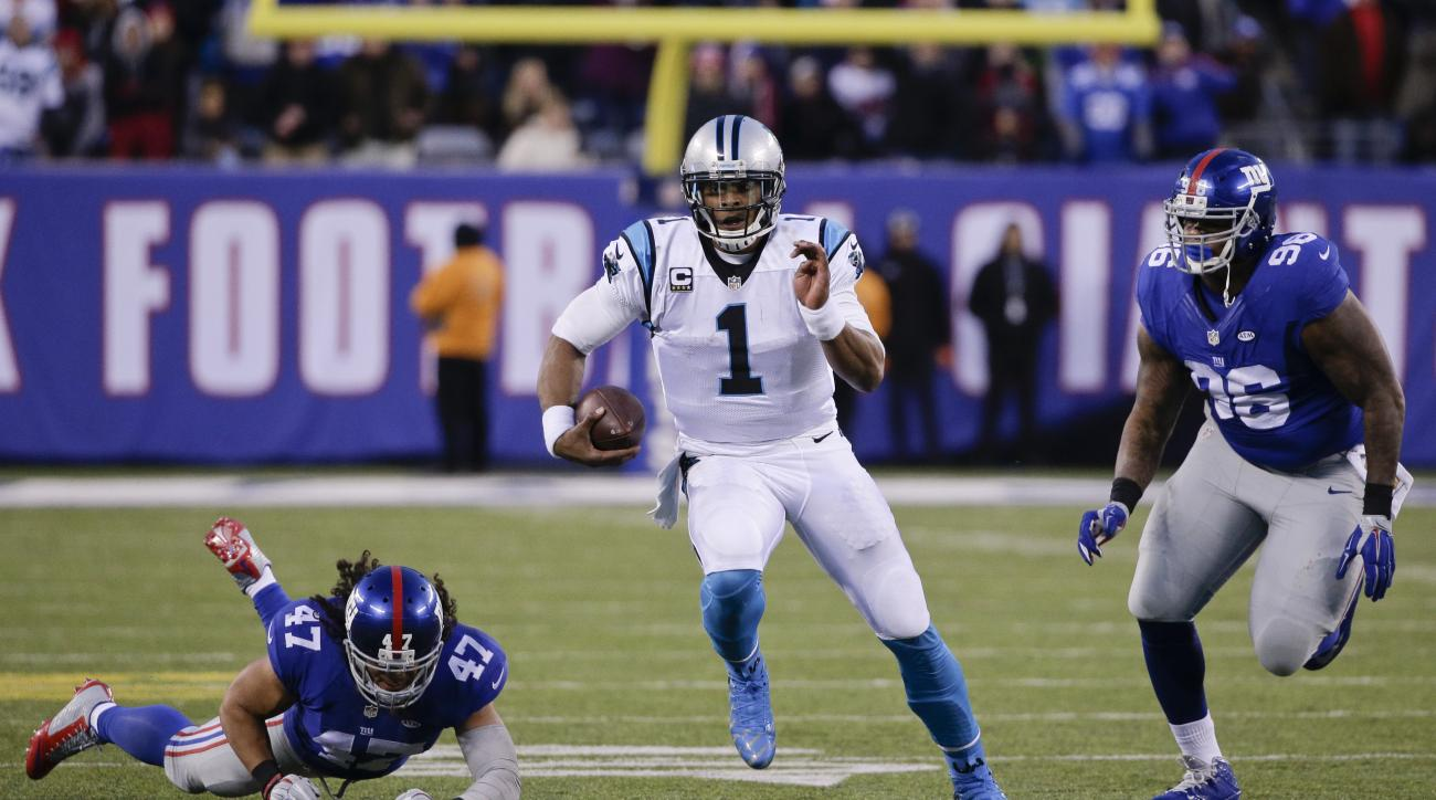 FILE - In this Dec. 20, 2015, file photo, Carolina Panthers' Cam Newton (1) runs away from New York Giants' Jay Bromley (96) and Uani' Unga (47) during the second half of an NFL football game, in East Rutherford, N.J. The Panthers (14-0) will try to clinc