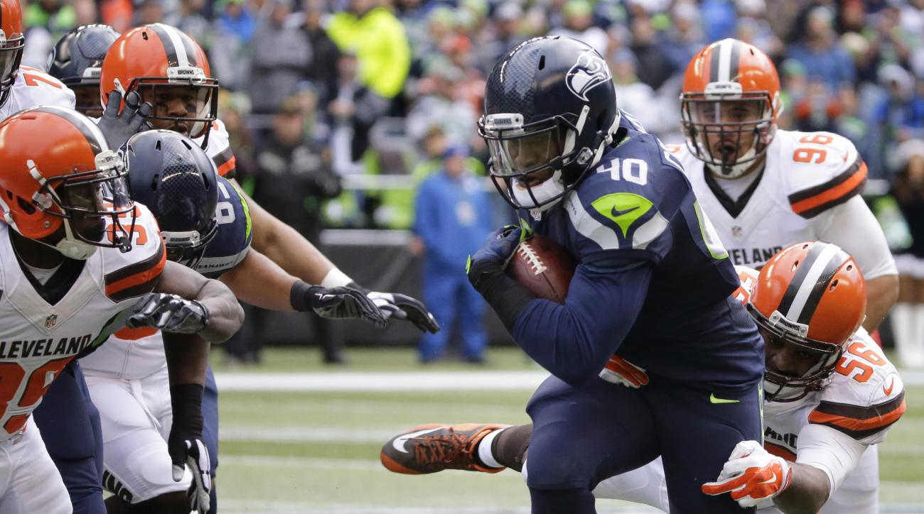 FILE - In this Dec. 20, 2015, file photo, Seattle Seahawks' Derrick Coleman runs with the ball against the Cleveland Browns in the first half of an NFL football game, in Seattle. The Seahawks play the St. Louis Rams on Sunday, Dec. 27, in Seattle. (AP Pho