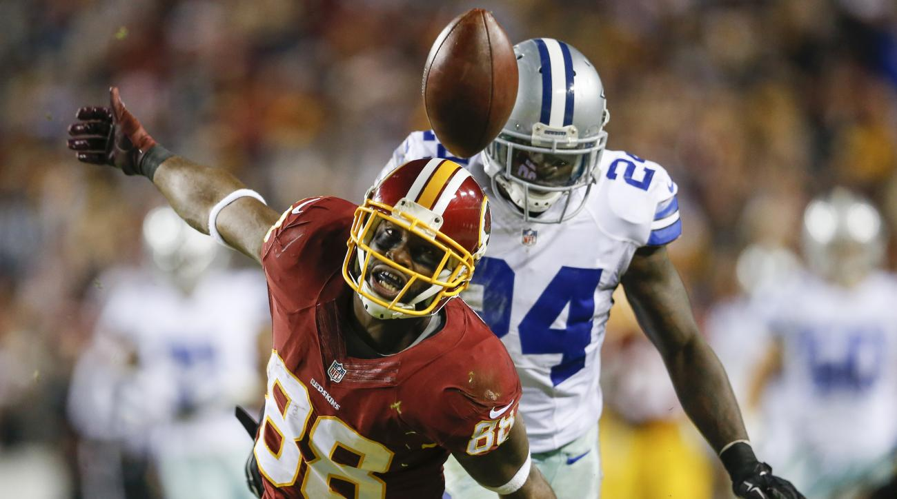 FILE - In this Dec. 7, 2015, file photo, Washington Redskins wide receiver Pierre Garcon (88) watches a pass get away from him under pressure from Dallas Cowboys cornerback Morris Claiborne (24) during the second half of an NFL football game in Landover,
