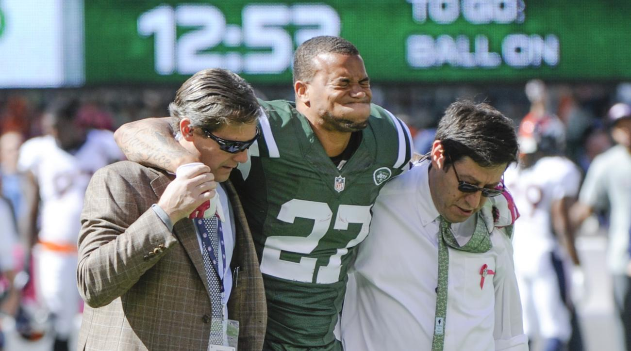 New York Jets cornerback Dee Milliner (27) is helped off the field with an ankle injury against the Denver Broncos in the first quarter of an NFL football game, Sunday, Oct. 12, 2014, in East Rutherford, N.J. (AP Photo/Bill Kostroun)