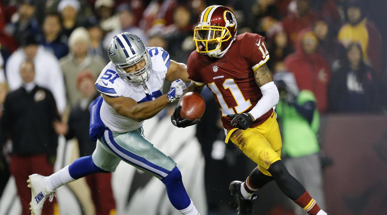 FILE - In this Dec. 7, 2015, file photo, Washington Redskins wide receiver DeSean Jackson (11) carries the ball on a kickoff return under pressure from Dallas Cowboys outside linebacker Kyle Wilber (51) during the second half of an NFL football game in La