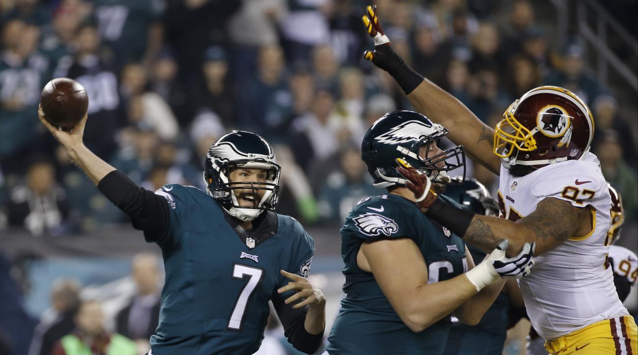 Philadelphia Eagles' Sam Bradford passes in the first half of an NFL football game against the Washington Redskins, Saturday, Dec. 26, 2015, in Philadelphia.  (AP Photo/Michael Perez)