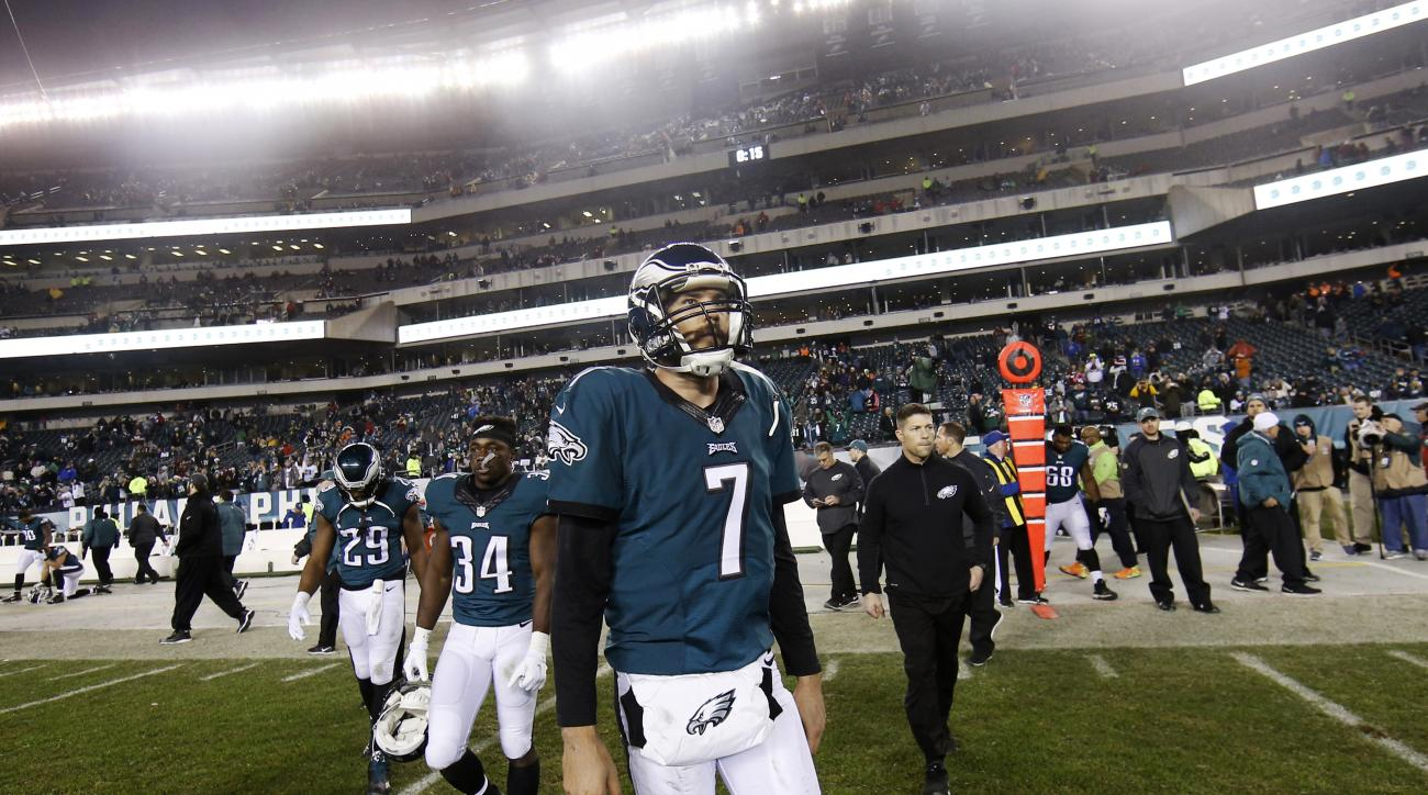 Philadelphia Eagles' Sam Bradford walks onto the field after an NFL football game against the Washington Redskins, Saturday, Dec. 26, 2015, in Philadelphia. Washington won 38-24. (AP Photo/Michael Perez)