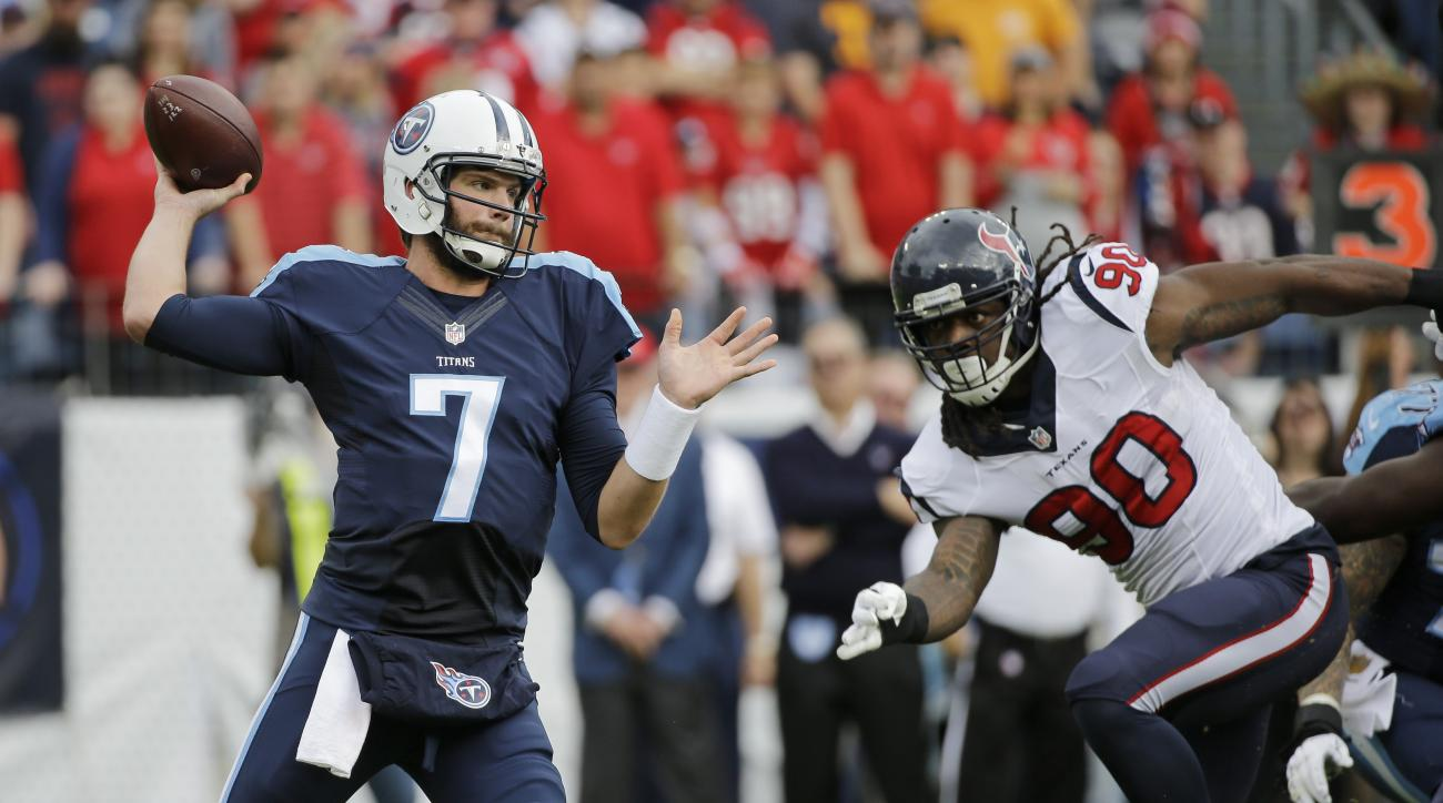 Tennessee Titans quarterback Zach Mettenberger (7) passes as Houston Texans outside linebacker Jadeveon Clowney rushes in the first half of an NFL football game Sunday, Dec. 27, 2015, in Nashville, Tenn. (AP Photo/James Kenney)