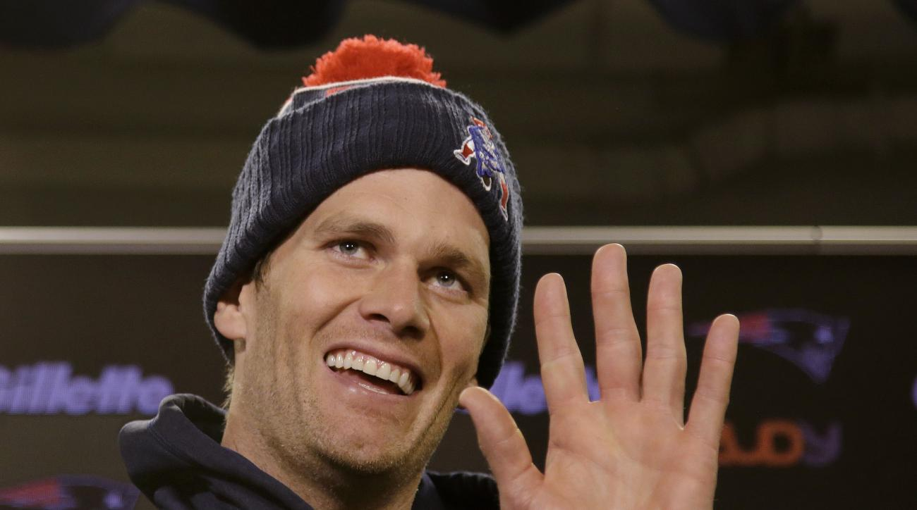 FILE - In this Wednesday, Dec. 16, 2015, file photo, New England Patriots quarterback Tom Brady smiles and waves goodbye to the media after being asked by a reporter about his supposed friendship with Republican presidential hopeful Donald Trump at the NF