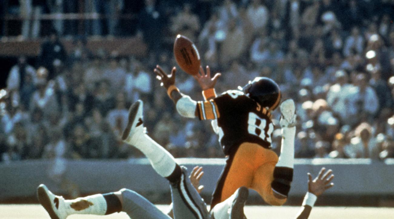 FILE - In this Jan. 18, 1976, file photo, Pittsburgh Steelers' Lynn Swann makes a diving catch against the Dallas Cowboys during NFL football's Super Bowl X at the Orange Bowl in Miami.  The Steelers won the Super Bowl for the second consecutive year and