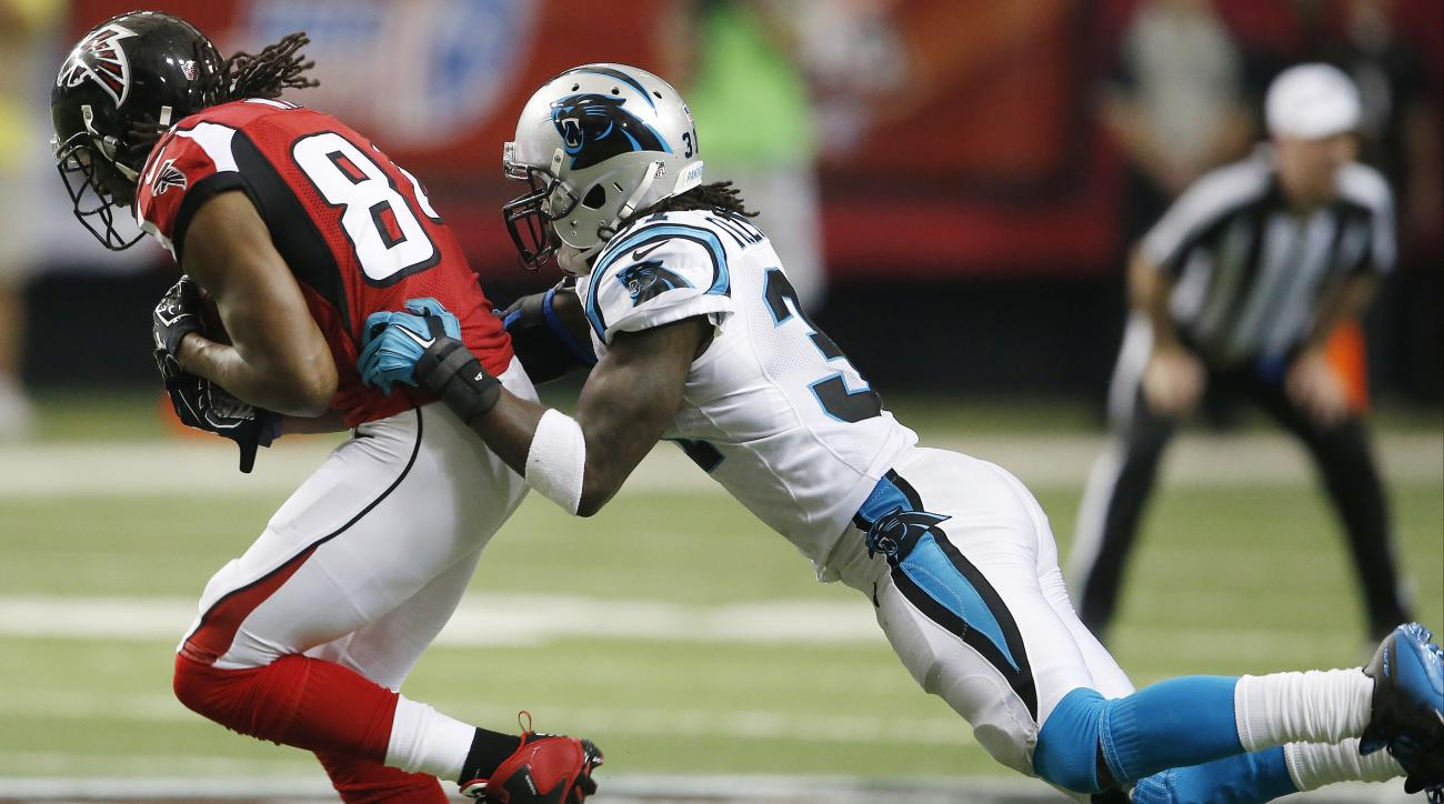Atlanta Falcons wide receiver Roddy White (84) runs as Carolina Panthers cornerback Charles Tillman (31) defends during the second half of an NFL football game, Sunday, Dec. 27, 2015, in Atlanta. (AP Photo/John Bazemore)