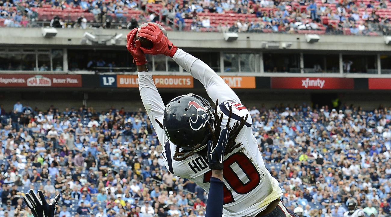 Houston Texans wide receiver DeAndre Hopkins (10) catches a 15-yard touchdown pass over Tennessee Titans cornerback Coty Sensabaugh (24) in the second half of an NFL football game Sunday, Dec. 27, 2015, in Nashville, Tenn. (AP Photo/Mark Zaleski)