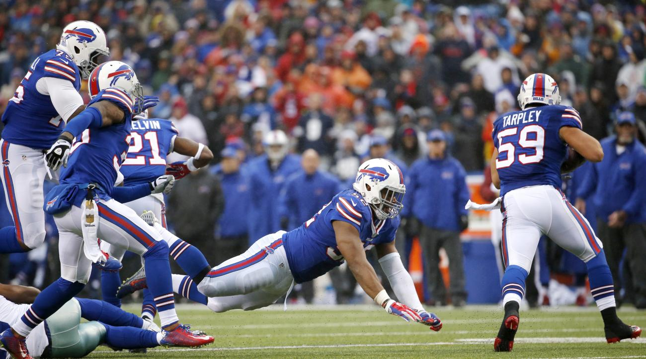 Buffalo Bills linebacker A.J. Tarpley (59) runs with the ball after intercepting a pass from Dallas Cowboys quarterback Kellen Moore during the second half of an NFL football game, Sunday, Dec. 27, 2015, in Orchard Park, N.Y. (AP Photo/Bill Wippert)
