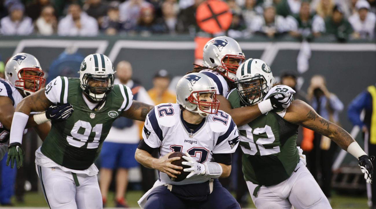 New England Patriots quarterback Tom Brady (12) is pressured by New York Jets' Sheldon Richardson (91) and Leonard Williams (92) during the second half of an NFL football game Sunday, Dec. 27, 2015, in East Rutherford, N.J. (AP Photo/Seth Wenig)