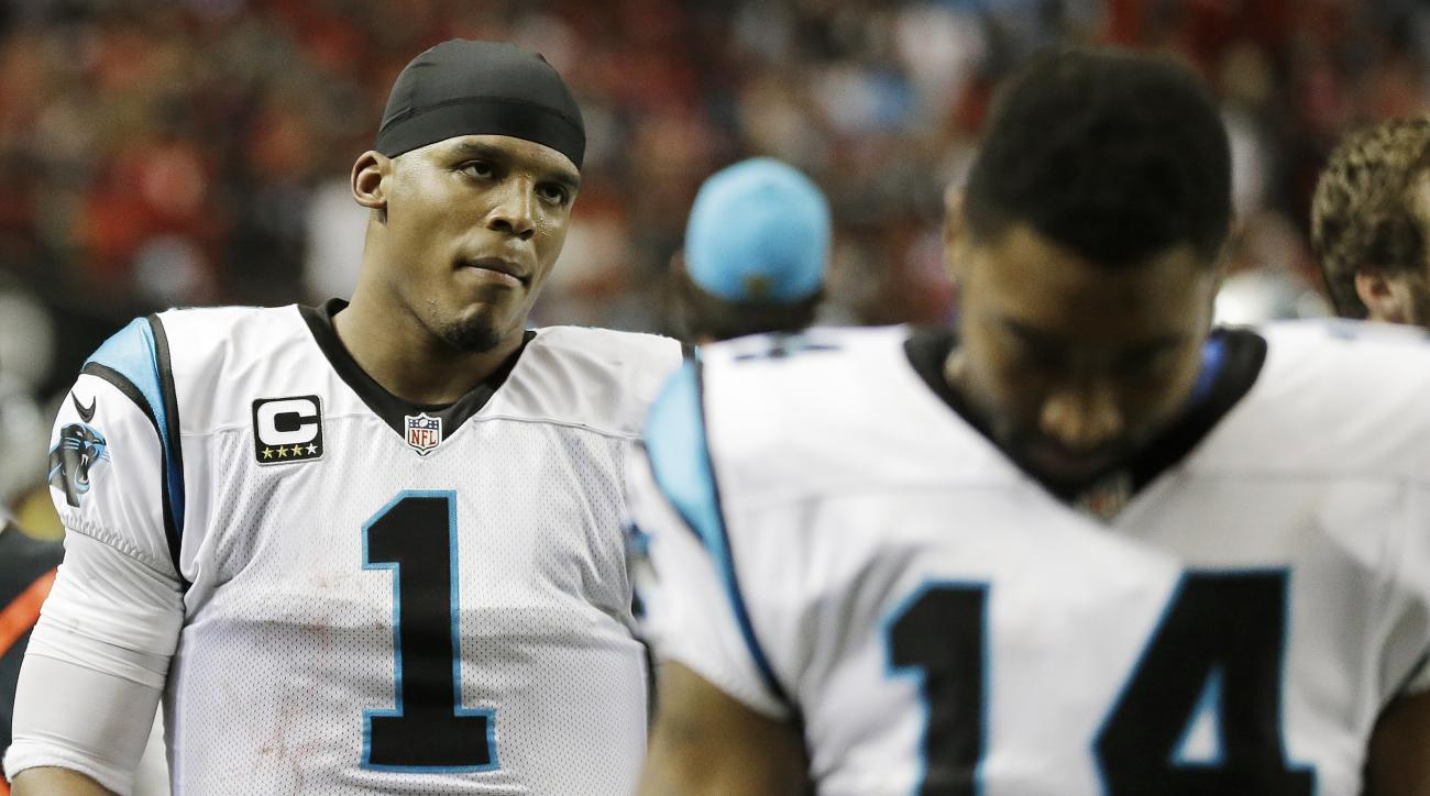 Carolina Panthers quarterback Cam Newton (1) walks off the field after the second half of an NFL football game against the Atlanta Falcons, Sunday, Dec. 27, 2015, in Atlanta. The Atlanta Falcons won 20-13. (AP Photo/David Goldman)