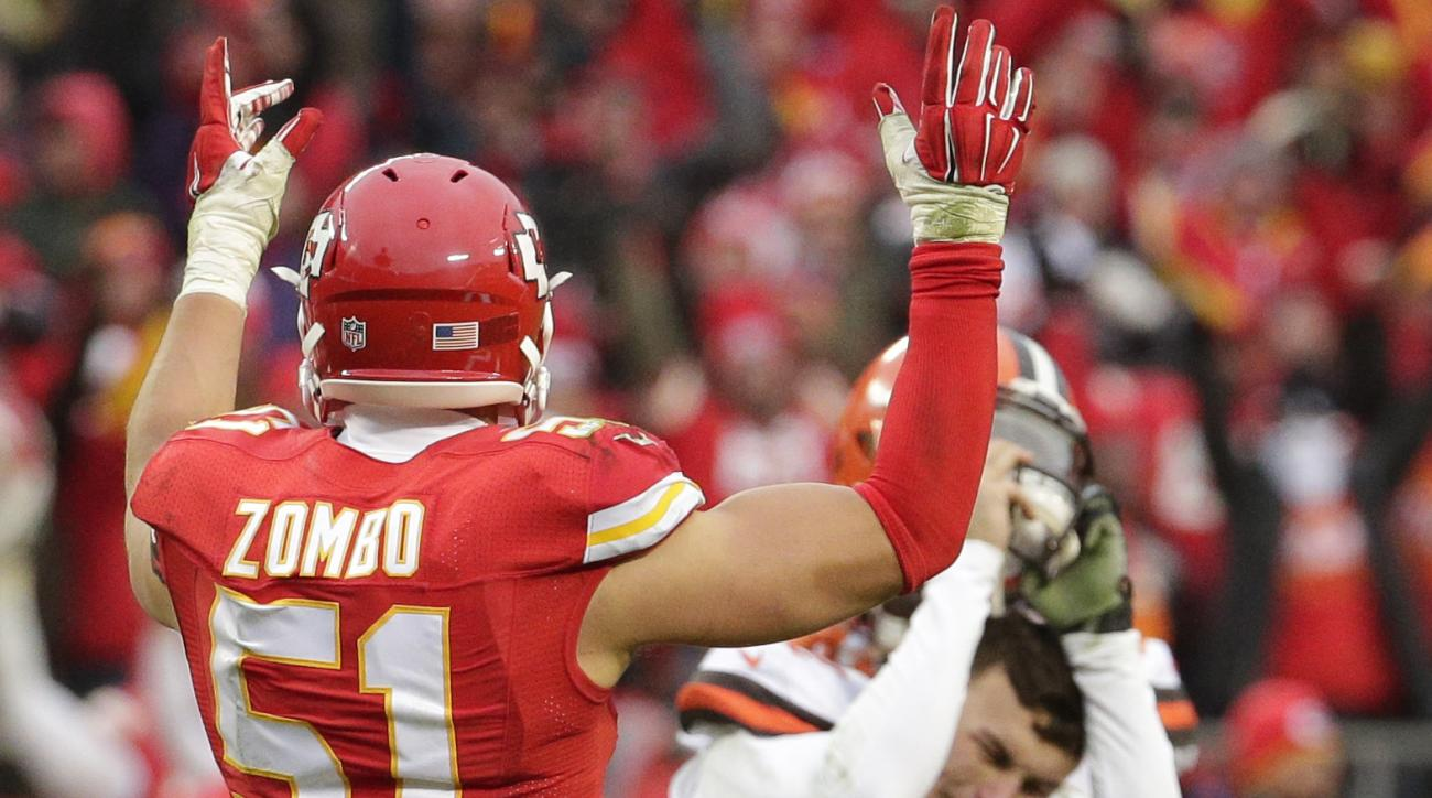 Cleveland Browns quarterback Johnny Manziel (2) slams his helmet as Kansas City Chiefs linebacker Frank Zombo (51) celebrates following an NFL football game in Kansas City, Mo., Sunday, Dec. 27, 2015. The Kansas City Chiefs won 17-13. (AP Photo/Charlie Ri