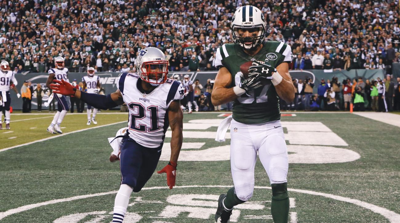 New York Jets wide receiver Eric Decker (87) catches a pass for a touchdown in front of New England Patriots' Malcolm Butler (21) during the overtime period of an NFL football game Sunday, Dec. 27, 2015, in East Rutherford, N.J. The Jets won 26-20. (AP Ph