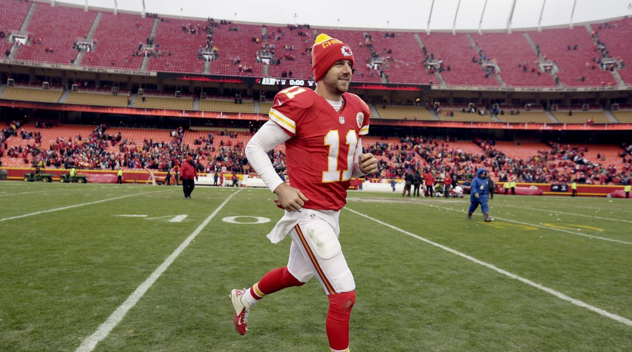 Kansas City Chiefs quarterback Alex Smith (11) runs off the field after an NFL football game against the Cleveland Browns, Sunday, Dec. 27, 2015, in Kansas City, Mo. Chiefs won 17-13. (AP Photo/Charlie Riedel)