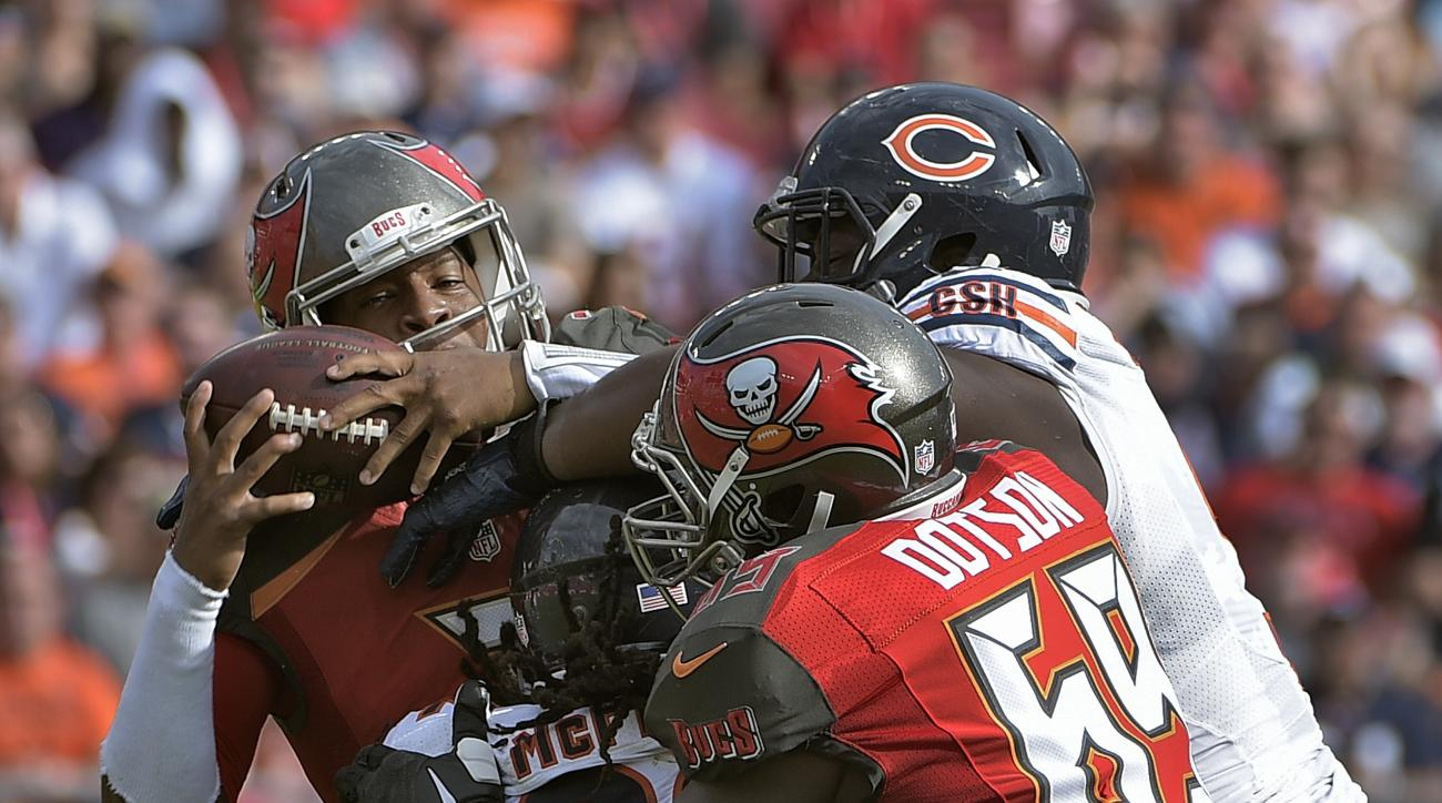 Tampa Bay Buccaneers quarterback Jameis Winston (3) is sacked by Chicago Bears outside linebacker Pernell McPhee (92) during the second quarter of an NFL football game Sunday, Dec. 27, 2015, in Tampa, Fla. Defending is tackle Demar Dotson (69). (AP Photo/