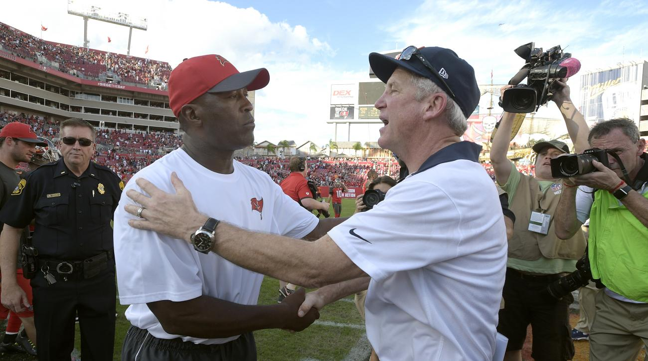 Chicago Bears head coach John Fox, right, shakes hands with Tampa Bay Buccaneers head coach Lovie Smith after the Bears defeated the Buccaneers 26-21during an NFL football game Sunday, Dec. 27, 2015, in Tampa, Fla. (AP Photo/Phelan M. Ebenhack)