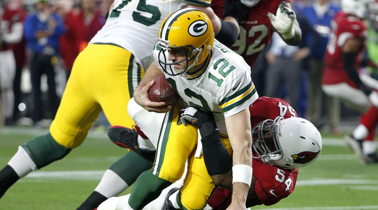Green Bay Packers quarterback Aaron Rodgers (12) is sacked by Arizona Cardinals inside linebacker Dwight Freeney during the second half of an NFL football game, Sunday, Dec. 27, 2015, in Glendale, Ariz. (AP Photo/Ross D. Franklin)