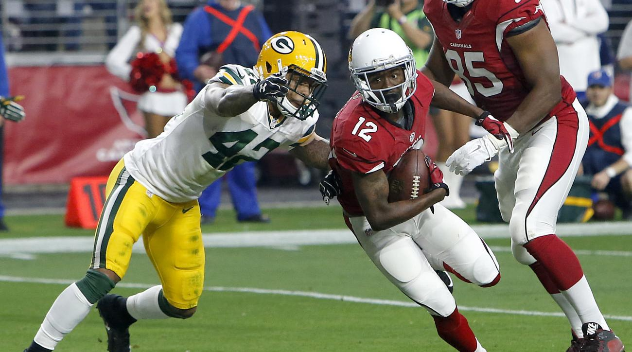 Arizona Cardinals wide receiver John Brown (12) scores a touchdown as Green Bay Packers strong safety Morgan Burnett (42) defends during the first half of an NFL football game, Sunday, Dec. 27, 2015, in Glendale, Ariz. (AP Photo/Rick Scuteri)