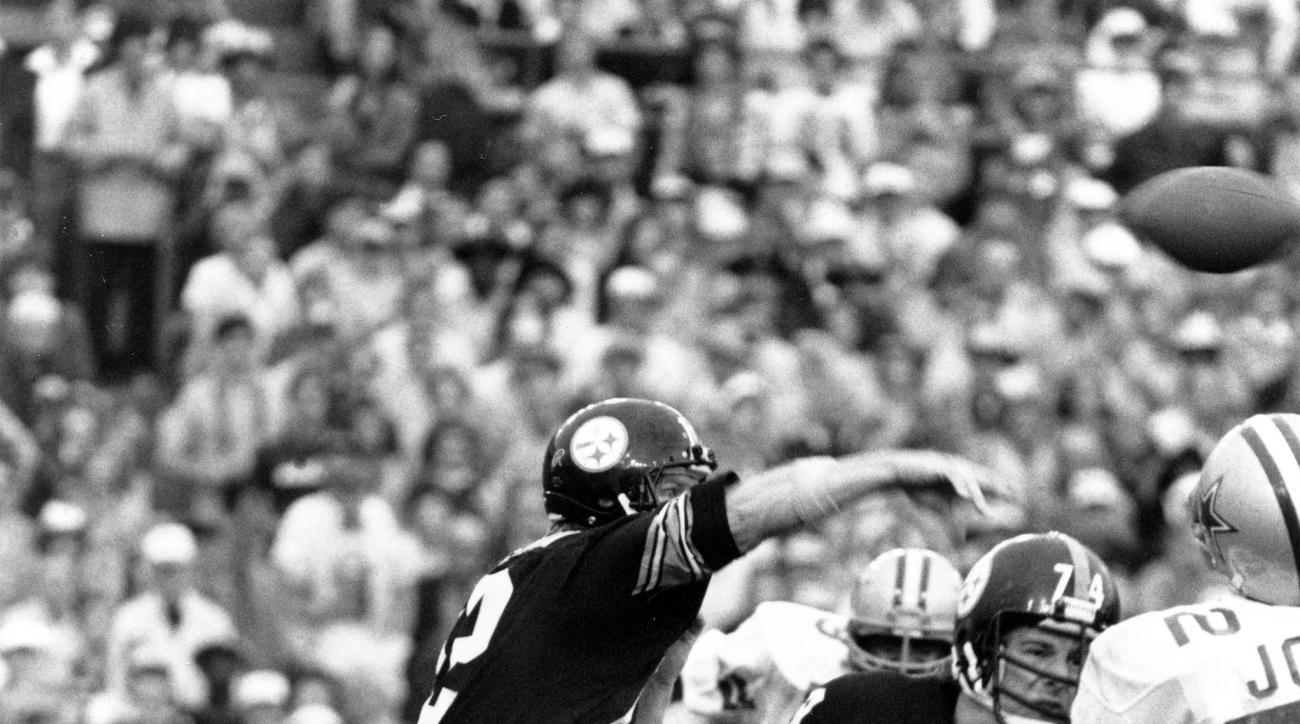 FILE - In this Jan. 21, 1979, file photo, Pittsburgh Steelers quarterback Terry Bradshaw, left, passes during NFL football's Super Bowl XIII against the Dallas Cowboys in Miami. Bradshaw, voted the game's most valuable player, completed 17 of 30 passes fo