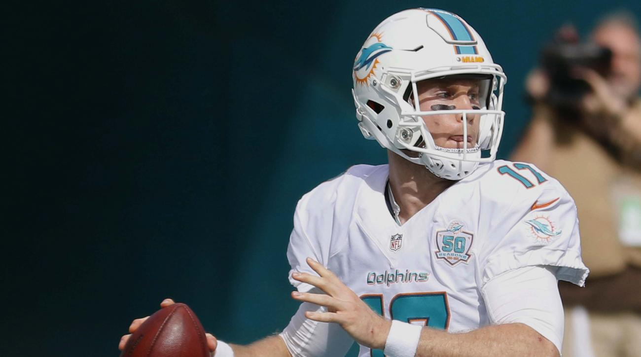 FILE - In this Dec. 27, 2015, file photo, Miami Dolphins quarterback Ryan Tannehill looks to pass during the first half of an NFL football game against the Indianapolis Colts in Miami Gardens, Fla. The Dolphins' latest loss has prompted a Twitter tirade f