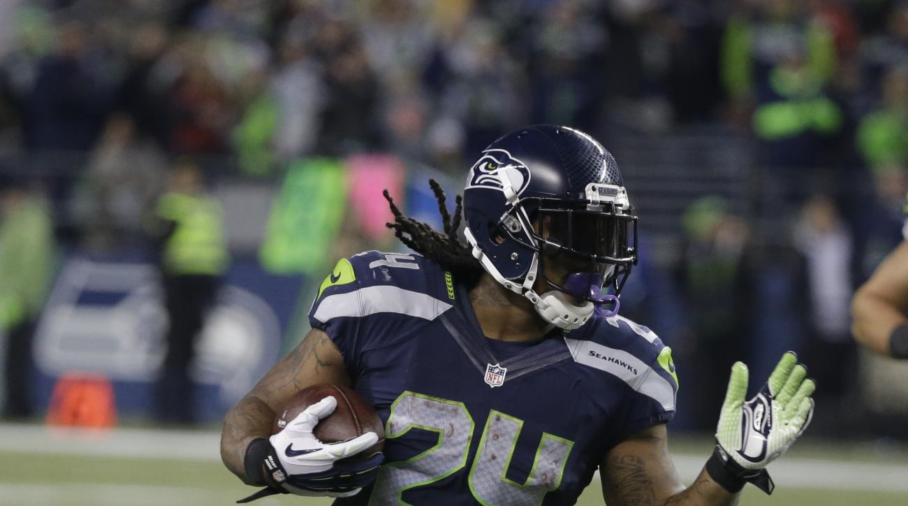 File- This Nov. 15, 2015, file photo shsows Seattle Seahawks running back Marshawn Lynch rushing against the Arizona Cardinals in the second half of an NFL football game, in Seattle. Lynch missed 2  games early in the season with hamstring/calf problems t