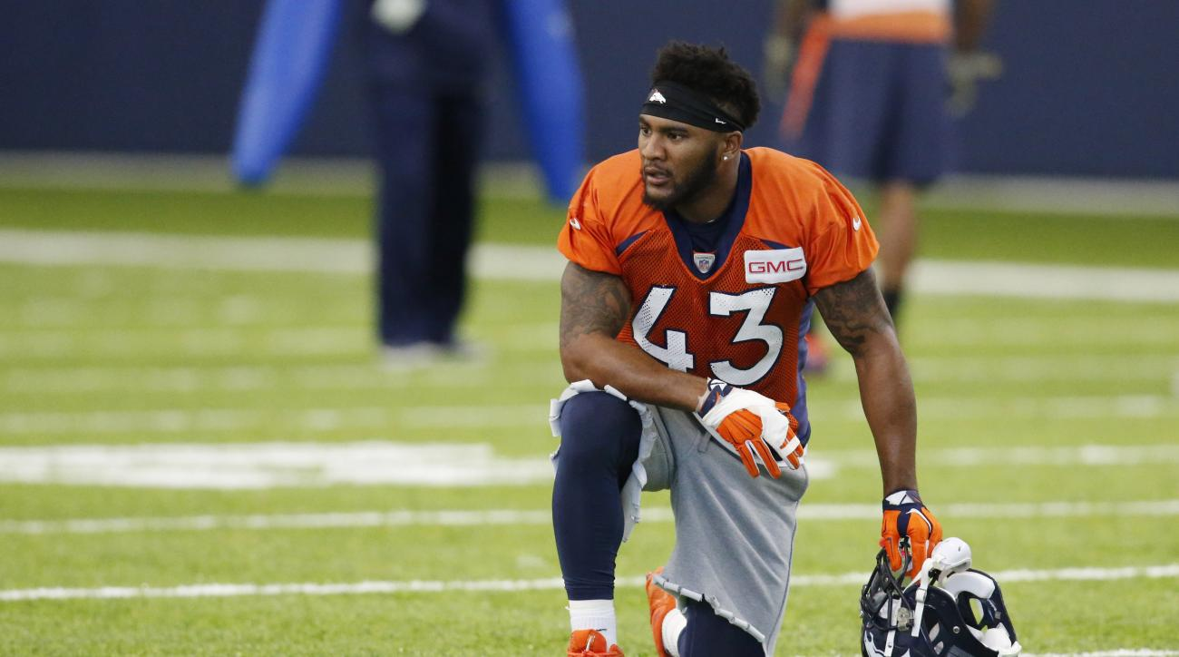 Denver Broncos strong safety T.J. Ward takes a break during a practice session at the team's headquarters Wednesday, Nov. 18, 2015, in Englewood, Colo. (AP Photo/David Zalubowski)
