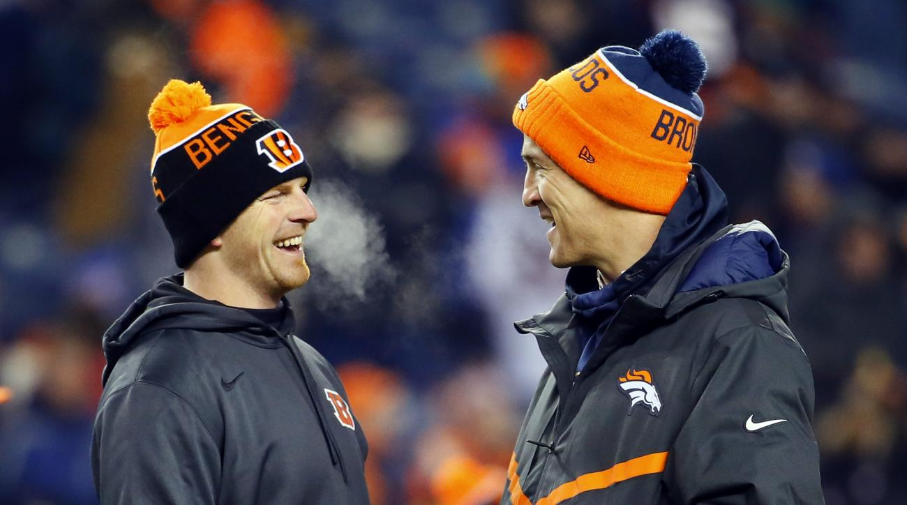 Cincinnati Bengals quarterback Andy Dalton and Denver Broncos quarterback Peyton Manning talk prior to an NFL football game, Monday, Dec. 28, 2015, in Denver. (AP Photo/Jack Dempsey)