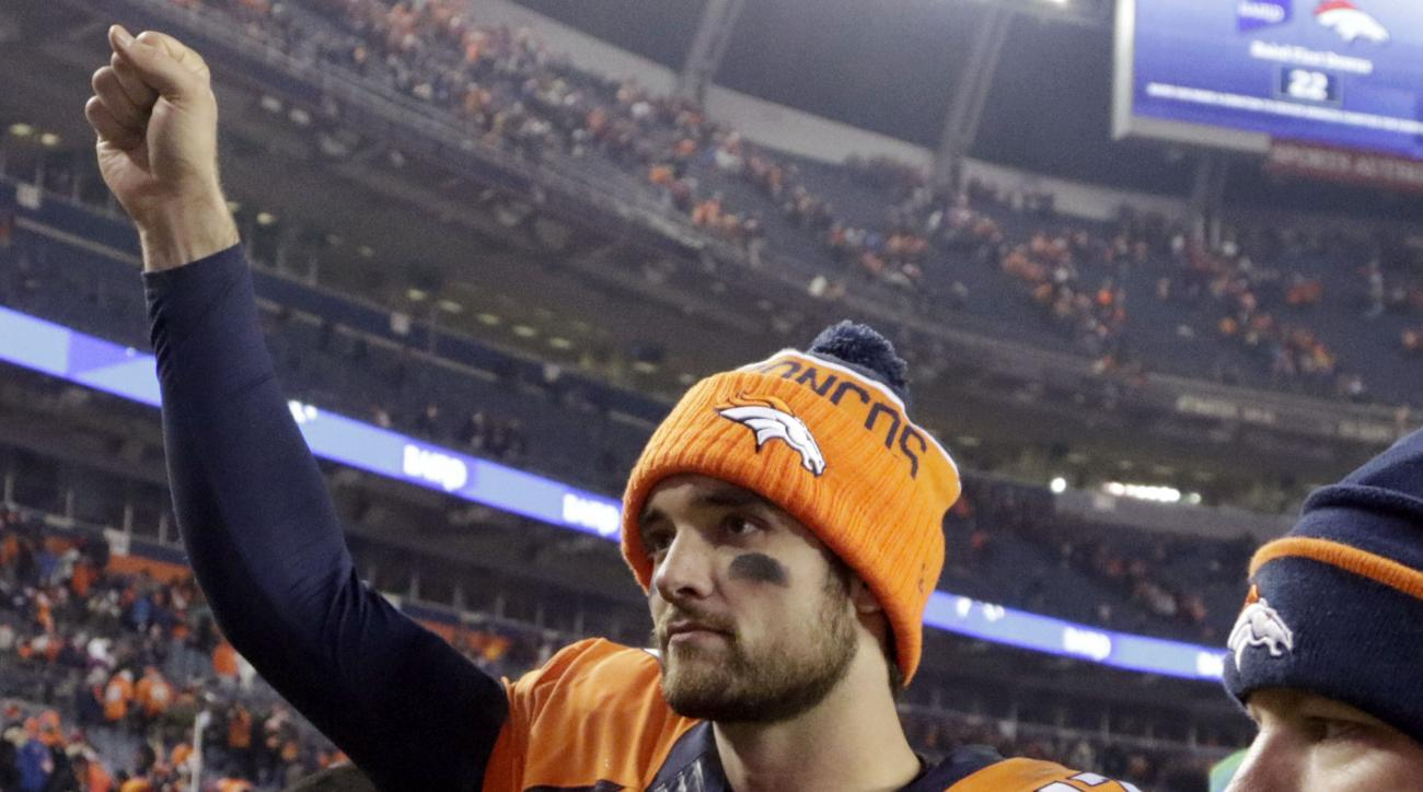 Denver Broncos quarterback Brock Osweiler (17) leaves the field after an NFL football game against the Cincinnati Bengals, Monday, Dec. 28, 2015, in Denver. The Broncos won 20-17 in overtime. (AP Photo/Joe Mahoney)
