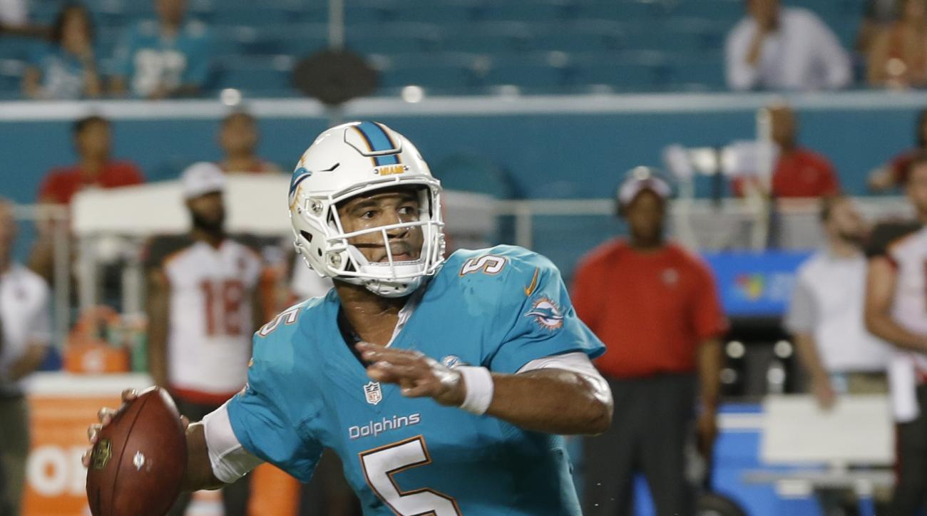 Miami Dolphins quarterback Josh Freeman (5) looks to pass during the second half of an NFL preseason football game against the Tampa Bay Buccaneers, Thursday, Sept. 3, 2015, in Miami Gardens, Fla. The Bucs defeated the Dolphins 22-17. (AP Photo/Wilfredo L