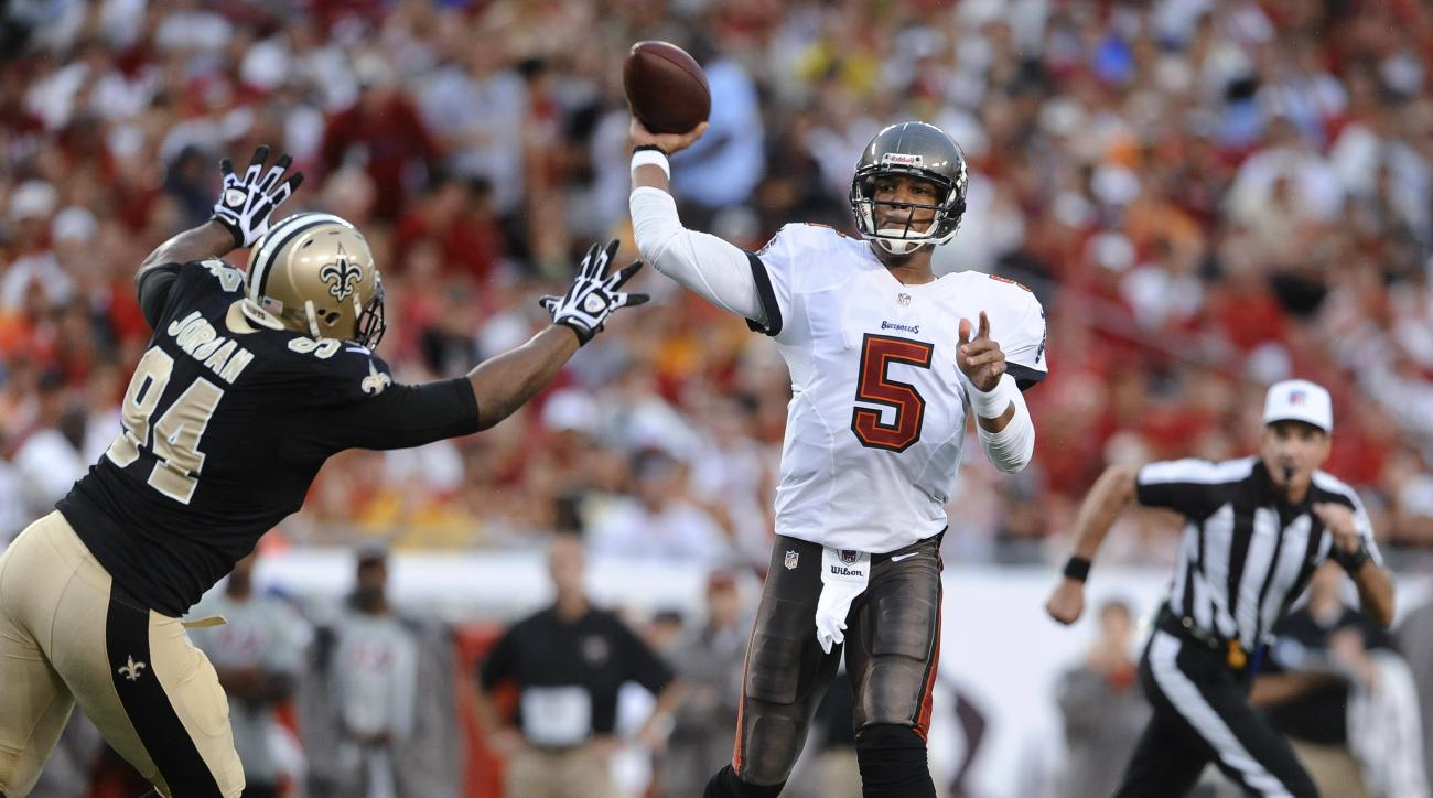 FILE - In this Sept. 15, 2013, file photo, Tampa Bay Buccaneers quarterback Josh Freeman (5) is pressured by New Orleans Saints defensive end Cameron Jordan (94) as he throws a pass during an NFL football game in Tampa, Fla. With Indianapolis' top three q