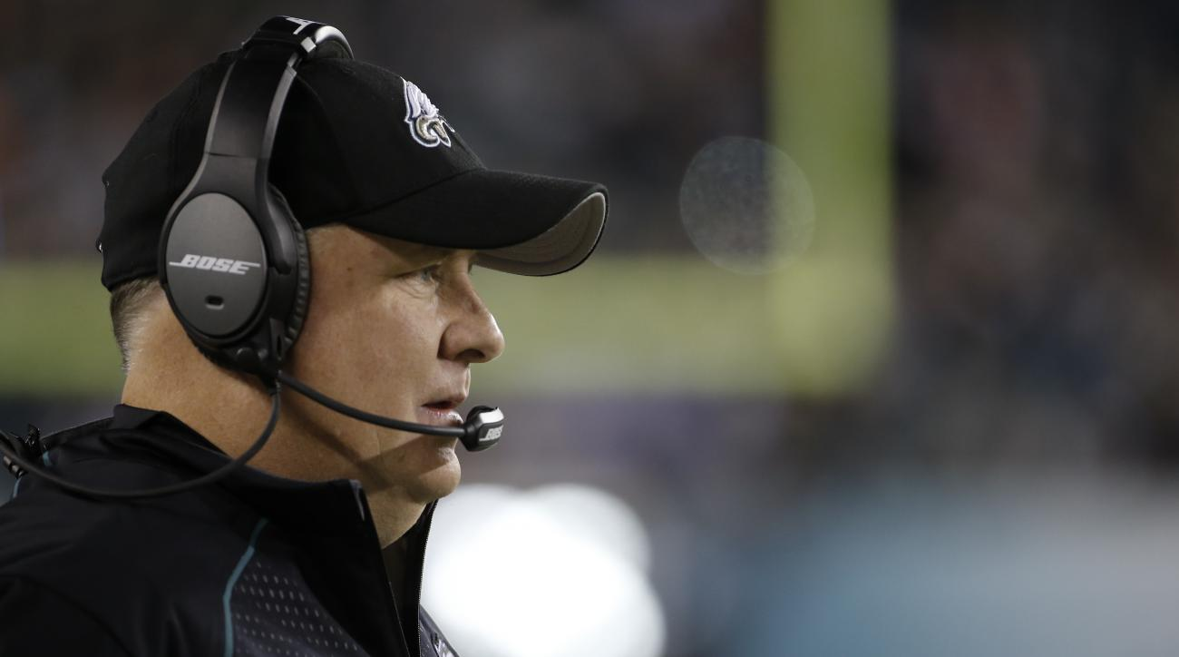 This Dec. 26, 2015 shows Philadelphia Eagles head coach Chip Kelly watching from the sidelines before an NFL football game against the Washington Redskins in Philadelphia. The Eagles fired Kelly with one game left in his third season, dumping the coach af