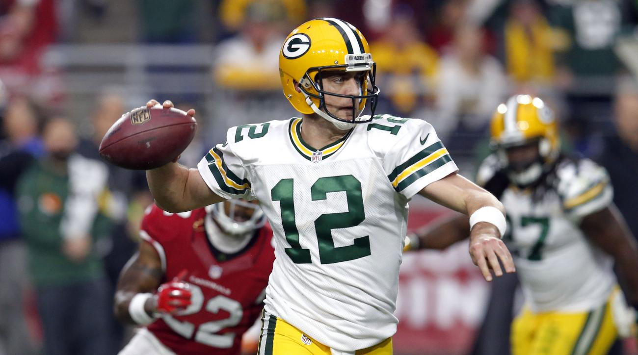 FILE - In this Sunday, Dec. 27, 2015, file photo, Green Bay Packers quarterback Aaron Rodgers (12) looks to throw against the Arizona Cardinals during the first half of an NFL football game in Glendale, Ariz. The offensive line is battered. The running ga