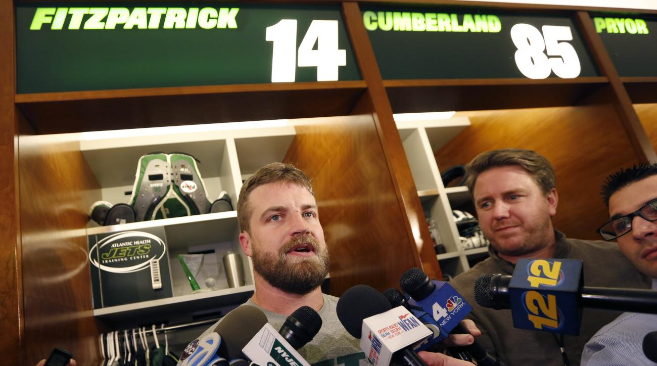New York Jets quarterback Ryan Fitzpatrick speaks to reporters in front of his locker at the team's NFL football training facility Wednesday, Dec. 30, 2015, in Florham Park, N.J. The Jets are preparing for Sunday's game against the Buffalo Bills and forme