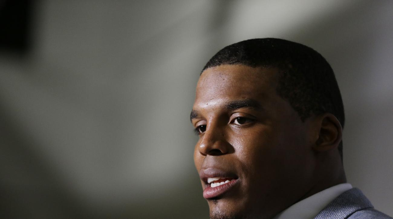 FILE - In this Dec. 27, 2015 file photo, Carolina Panthers quarterback Cam Newton speaks after an NFL football game against the Atlanta Falcons in Atlanta. Newton said Wednesday, Dec. 30, on Twitter that his longtime girlfriend had a son last week. (AP Ph