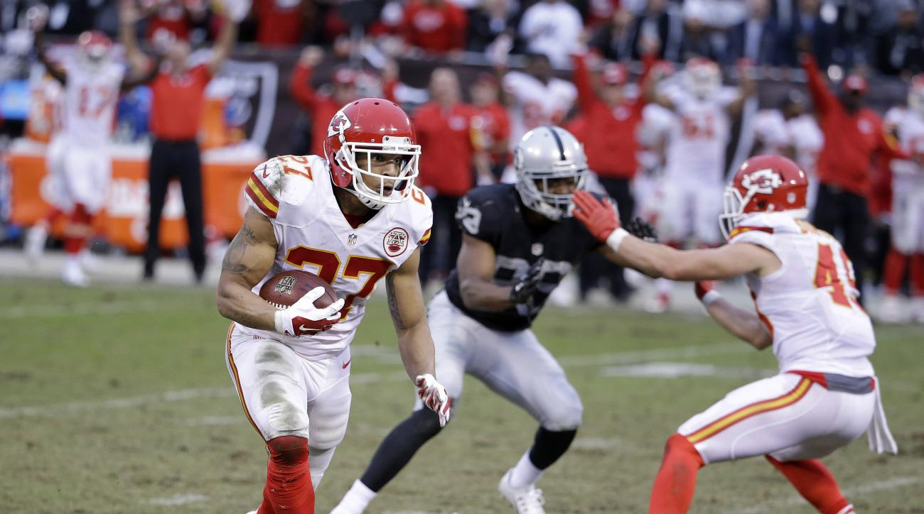 FILE - In this Dec. 6, 2015, file photo, Kansas City Chiefs defensive back Tyvon Branch (27) returns an interception from Oakland Raiders quarterback Derek Carr for a touchdown during an NFL football game in Oakland, Calif. The Chiefs won 34-20. The teams