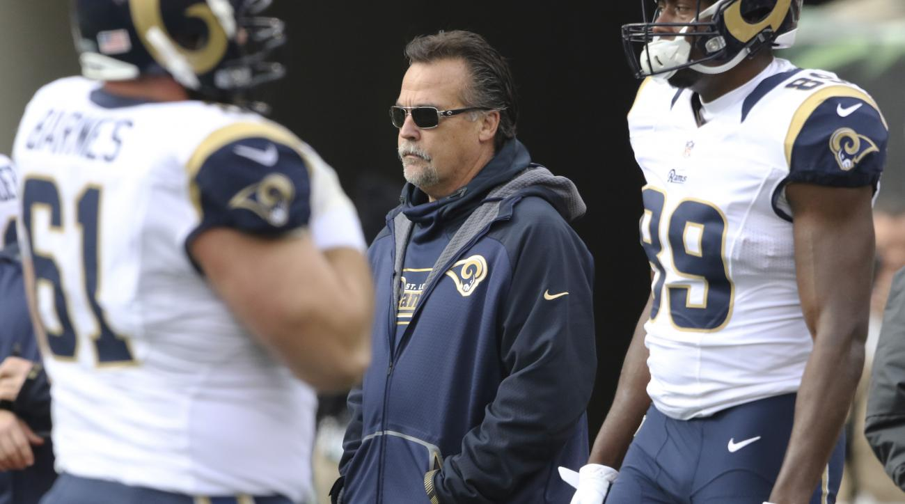 FILE - In this Nov. 29, 2015, file photo, St. Louis Rams coach Jeff Fisher stands on the field before the team's NFL football game against the Cincinnati Bengals in Cincinnati. The Rams play the San Francisco 49ers on Sunday, Jan. 3. (AP Photo/Gary Lander