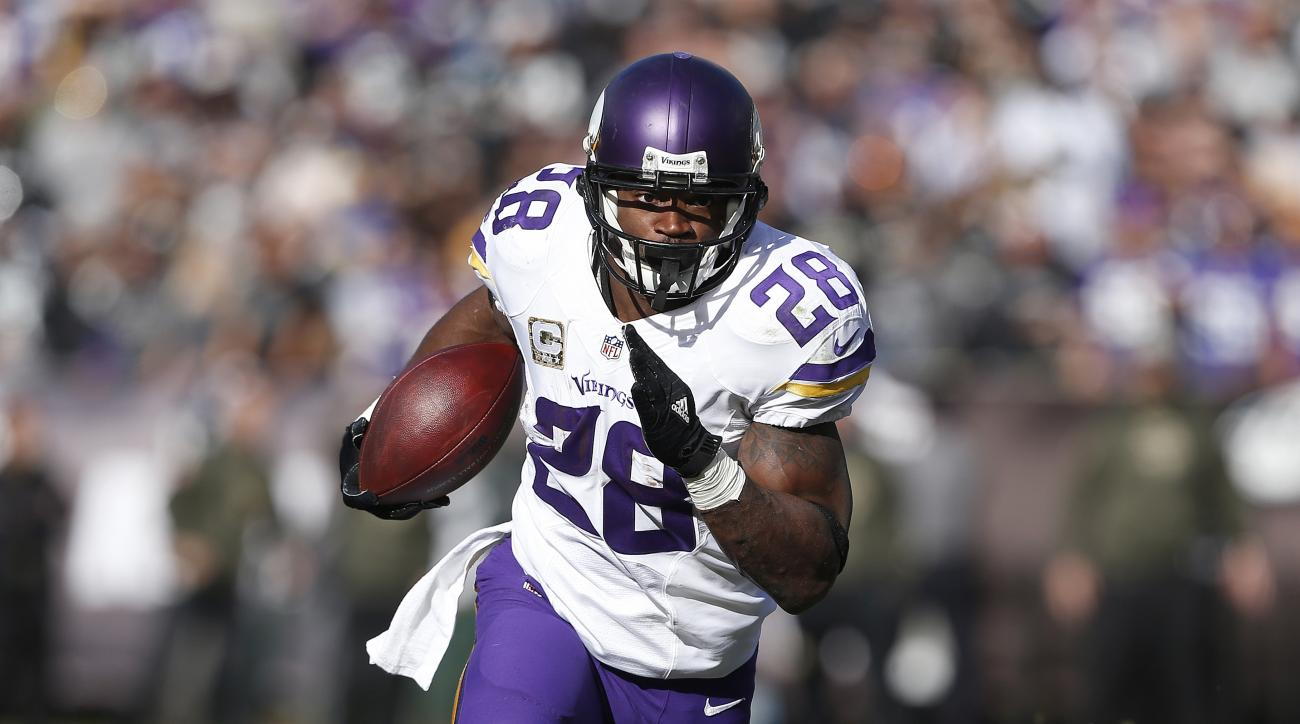 FILE - In this Nov. 15, 2015, file photo, Minnesota Vikings running back Adrian Peterson carries against the Oakland Raiders during an NFL football game in Oakland, Calif. The Vikings play the Green Bay Packers on Sunday, Jan. 3. (AP Photo/Beck Diefenbach
