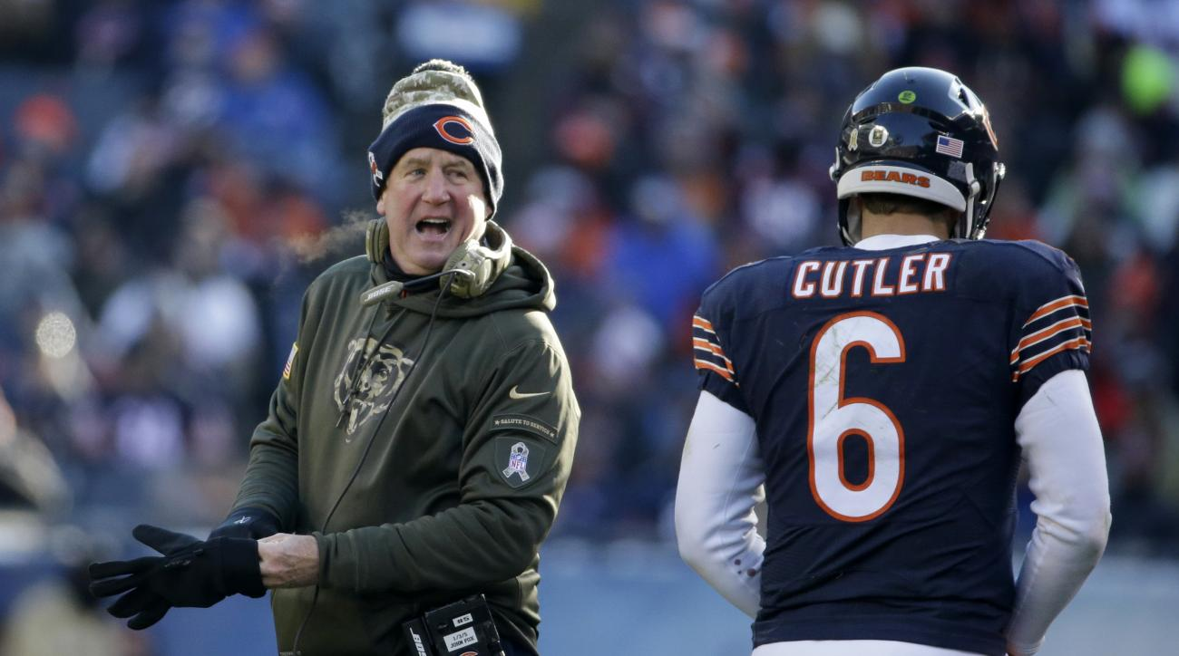 FILE - In this Nov. 22, 2015 file photo, Chicago Bears head coach John Fox talks to quarterback Jay Cutler (6) as Cutler walks to the bench during the second half of an NFL football game against the Denver Broncos in Chicago. Fox's new team trailed the Br