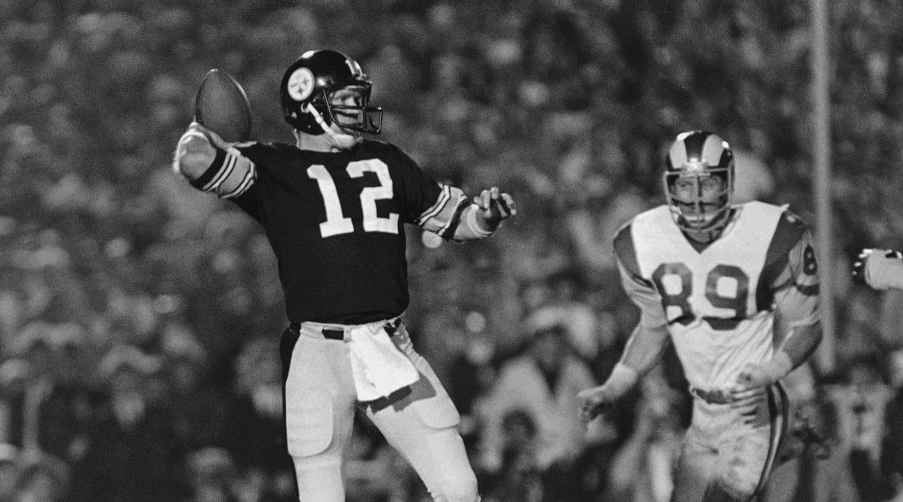 his FILE - In this Jan. 20, 1980, file photo, Pittsburgh Steelers quarterback Terry Bradshaw cocks arm to pass during NFL football's Super Bowl XIV in the Rose Bowl stadium in Pasadena, Calif. The Steel Curtain dynasty concluded as Bradshaw completed 14 o